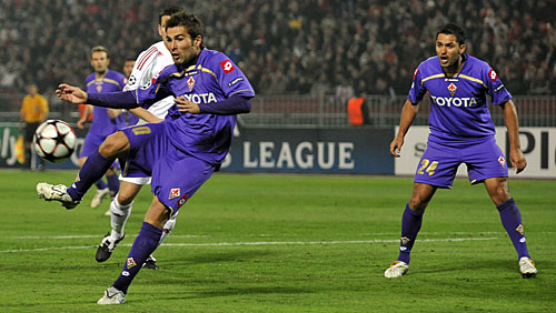 Adrian Mutu   (foreground)  displays  a  moment  of  grace  as   he   scores   a  goal  against  Debrecen   .   Fiorentina   would   go  on  to  defeat   Debrecen   4-3  .    picture  appears    courtesy  of  afp/getty  images/   Christian  Porter  ..................................