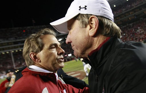 Alabama  coach,  Nick  Saban  is   greeted   by  his   opposite  number    Steve Spurrier  of   South  Carolina   after the  game   between  their   two   teams.    Alabama   overwhelmed     South  Carolina   20-6    in  a   very   lopsided  game   played   at  Bryant   Denny  Stadium  in Tuscaloosa  ,  Alabama ,.     picture  appears  courtesy   of   ap/photo/  Dave Martin     .........................