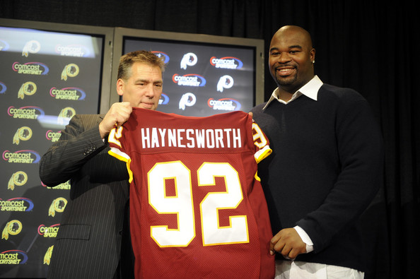 Haynesworth  seen  here  with   Redkins'  coach  Jim  Zorn