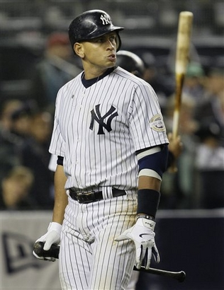 Yankees' third  baseman  Alex  Rodriguez  looks  at the   scoreboard  having   just  struck  out  in the  ninth   inning of  game  one   of the  World  Series.     picture  appears   courtesy  of  ap/photo /  David  J.  Phillip  ..............