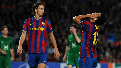 Barcelona   players   in the   foreground  are   stunned  in  disbelief  after    FK  Rubin   score the   first   goal  of the  game.  The   Russian  side  would   go  on to  defeat  the  Spanish   giants   2-1   in the  divisional   group  game.    picture  appears   courtesy   of    getty  images/    Renato   Gabriel   ...............................