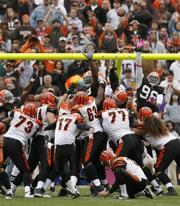 Bengals'   kicker  Shayne  Graham (17)  kicks  the  winning  field   goal  in  overtime  that  enables  the  win  over  the  Cleveland Browns .      picture  appears  courtesy  of  ap/photo/ The Repository,   Scott  Heckel   ..........................