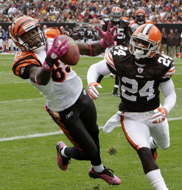 Bengals'  wide  receiver  Chad Ochocinco (85) catches  a  5 yd  touchdown  reception  infront  of  Browns'   cornerback  Eric  Wright  .    The   Bengals   would   go  on  to   defeat  the  Browns   23-20   in  the  AFC North  divisional   matchup.       picture   appears  courtesy  of  ap/photo/  Mark  Duncan  .......................