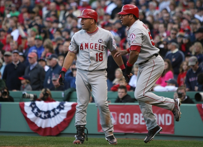 Bobby  Abreu (right) and  teammate  Kendry  Morales (left)  are   euphorical  after  scoring   to  put   the  Angels    in  the   lead  over  the    Boston  Red  Sox.     The  two   runs   batted  in   were   by  teammate   Vladimir   Guerrero   .        picture   appears   courtesy  of   getty  images/    Elsa   .....................