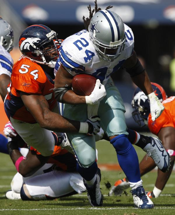 067ff0532 Broncos  defensive player Andra Davis(54) tackles Cowboys  running back  Marion Barber
