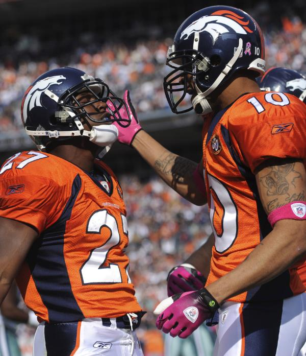 Broncos running  back  Knowshon  Moreno  is  congratulated  by  teammate   Jabar  Gaffney  after   Moreno' s   second   quarter   touchdown  against  the  Cowboys.  Broncos'  running back  Knowshon  Moreno (27) is congratulated  by teammate  Jabar Gaffney (10) after  Moreno's   second   quarter  touchdown against  the  Dallas  Cowboys   in a   game  played  at  Invesco  Field  in  Denver , Colorado.   The   Broncos   would    go on  to defeat  the  Cowboys   17-10   in the game.  The  Dallas  Cowboys   now  sit  at  2-2  within the  NFC  East.  While  the  Broncos (4-0) are   one  of    4   unbeaten  teams  within  the  NFL  .       picture  appears   courtesy  of ap/photo/ Chris  Schneider  .............