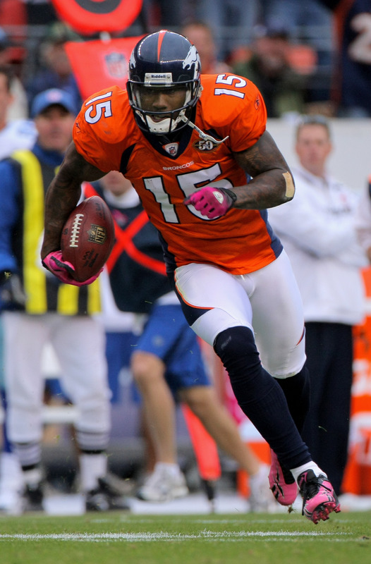 Broncos' wide receiver   Brandon Marshall (15)  scampers  his   way to  the  game  winning  51 yard  touchdown   reception  triumph  over the  Dallas  Cowboys  .      picture   appears  courtesy  of  getty  images/  Doug  Pensinger  .....................