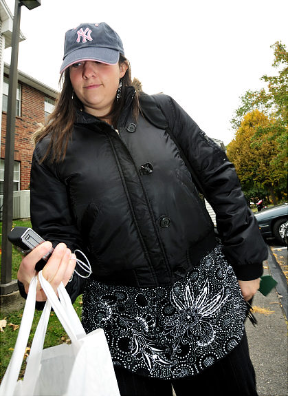 Brooke  Hundley, 22,    ESPN  production  assistant  at the  center  of  attention   in  the  Steve  Phillips   sex  scandal and  affair.    Hundley  and  the  46  year  old   Phillips  it  has been  alleged   carried   on  a  sordid   affair   over   a  prolonged   period  of    time.    Hundley  seen  here  is   leaving   her   appartment   complex  in  Bristol   Connecticut.       picture   appears  courtesy  of   ap/photo .....................