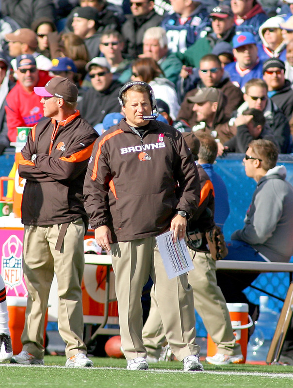 Browns'  coach  Eric  Mangini   stands  on the  sidelines  as  he  watches  his   team   play the  Buffalo  Bills  at  Ralph  Wilson  Stadium,   Orchard Park,  NY.   The   Browns  would   end  up  defeating  the  Bills  6-3   in a  thoroughly   deplorable  game  that  was  poorly  executed   in  every  facet.    picture   appears  courtesy  of   getty  images/  Rick  Stewart   .....................