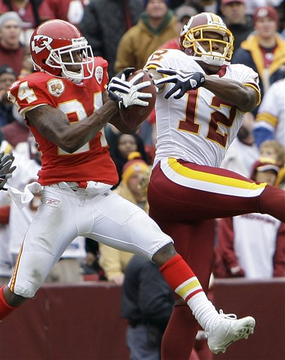 Chiefs'  cornerback   Brandon  Flowers,  left,  intercepts   a  pass  intended  for    Redskins'   wide   receiver   Malcolm   Kelly  .     picture  appears  courtesy  of  ap/photo/ Alex Brandon      .........................