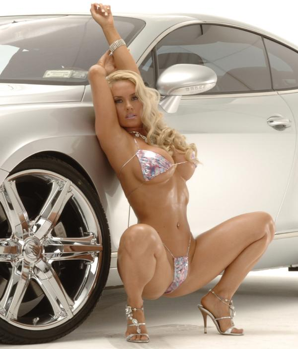 Austin  makes   even  this   luxury   vehicle   seem  oblivious   as   she   shows   off   her   wiles.