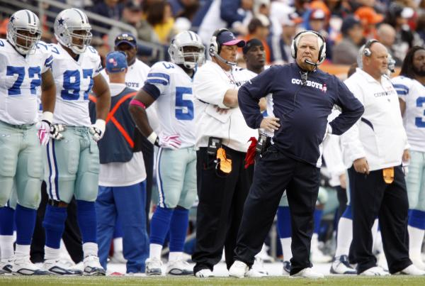 Cowboys'  coach   Wade  Phillips  looks  on as  the  Broncos  have   just   scored  the   game  winning   touchdown.    picture  appears  courtesy  of  ap/photo/  Jack  Dempsey   ............................