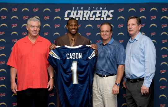 Dean  Spanos (center) President  and  CEO  of  the  San Diego  Charger   is  seen here  with  first  round  draft  pick  Antoine  Cason  from the  2008  NFL  Draft   to  his  immediate  left.   Right  is   Chargers'  coach   Norv  Turner  and   far  left  is  Chargers'  GM   A J Smith.   Spanos   now  deals  with  the  day   to   day   operations   of  the  fanchise   due to  his   fathers     Alex's   ill  health.     Any  decision  that  will  be  made    as  to  whether   or  not  the  franchise  embarks   upon  leaving the  city  will   be  ultimately    made  by   Spanos.   As  of  now   no  decision    has   been   forthcoming  as   the franchise  and  the  city  are   still  in  discussions.            picture  appears   courtesy   of    ap/photo/  Mary  Caldwell   ........................
