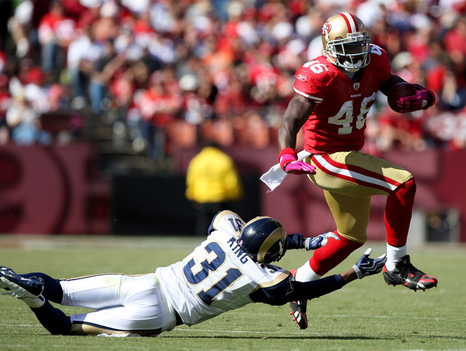 Delanie   Walker (46) of the  49ers   evades  the  vain  attempt  to  tackle  him  made   by the  Rams'  Justin King (31).   The   San  Francisco   49 ers   would   go  on  to   rout  the   St  Louis  Rams   35-0   in   the  NFL  game  played  at  Candlestick  Park  ,  San  Francisco  ,  California.   The   49ers  are  the  surprise  team  in the  NFC  West   this  season  having   started  off   3-1  and   they  now  sit  atop  of the   division.       picture  appears  courtesy of   getty images/ Jed  Jacobsohn   ............................