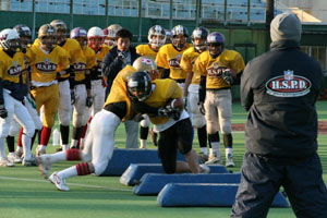First   year  high  school  players  in  Japan  learn  some  of  the  rudimentary   drills   .    picture  appears   courtesy  of  the  Japan  Times /  archives/   Kuzio  Katayama  ......................