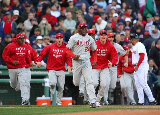 Gary  Matthews Jr (24) and   his teammates  of  the  Los  Angeles   Angeles   run   on  to the  field  to  celebrate  the  team's   7-6  victory  over  the   Boston  Red  Sox   at  Fenway   Park   in  Boston ,  Massachusetts .    The  Angels   swept  the  Red  Sox  3-0   in the  best   of   5  game   series   in  the  ALDS.  They   will  now   go  on  to  face  the  New York  Yankees   for  the  AL  Pennant  and  the  right  to   represent  the  AL  in  the  World  Series.        picture  appears   courtesy  of   getty  images/  Jim  Rogash  .......................