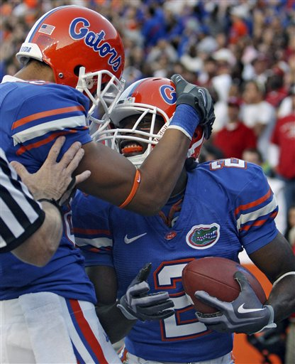Gators'  running  back   Jeffery  Demps  celebrates with   teammate  , wide  receiver    David Nelson,  after   scoring   a  10- yard  touchdown  in  the  fourth  quarter   against   Arkansas     played   in  Gainesville  ,  Fl.   The   Gators  would   go  on  to   defeat  the  Razorbacks  23-20   in  a hard  fought  game.   picture  appears  courtesy  of  ap/photo/ John  Raoux    .....................