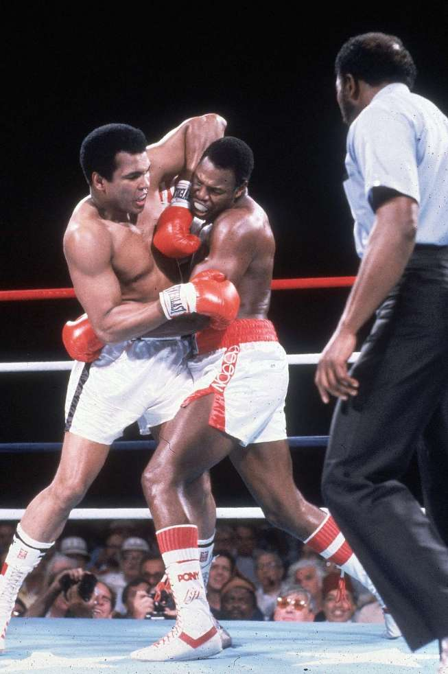 Ali (left)  seen  here  in the  ring  with   Holmes (right)   in their   match up  for  the  WBC  heavyweight title  bout held  at  Caesar's  Palace  in  Las Vegas , Nevada  .  The   fight  took   place    2nd  October   1980   .  It  was  Ali's  penultimate   fight   , which  he  lost  in  an  11th  round  TKO  decision to the  champion ,  Larry  Holmes.  In  his  last fight   Ali   would   also   lose  a  unanimous   verdict  to   Trevor  Berbick  of Canada.    picture  appears  courtesy of   John  Iacona  ..........   copyrighted  material      @  All  rights  reserved ...........