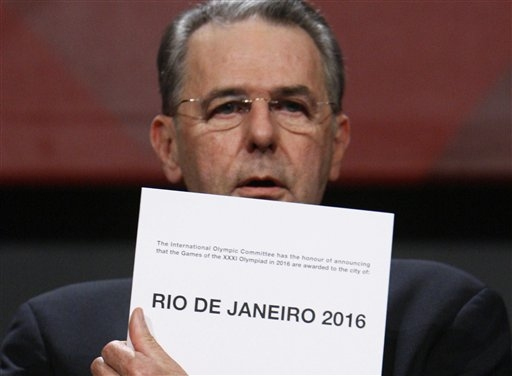 IOC Chairman  Jacques  Rogge   makes  the   formal  announcement  that  Rio  De  Janeiro   has  won the  final   vote and  has  been  awarded  the   2016   Olympic ( Summer )  Games  .   picture  appears  courtesy  of   ap/photo/  Bjorn    Rijjs  ...................