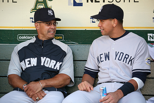 Jackson  (left)  now  a  special  consultant with the  New York  Yankees , sits   in the  dugout   alongside  Alex  Rodriguez .  Whatever  the  topic  of   discussion  might've   been  about.  I   doubt  it  had  anything  to  do  with  the  number  of  World  Series   rings   that  Jackson  has.          picture  appears  courtesy  of    ap/photo/  Rich  Creswell  ........................