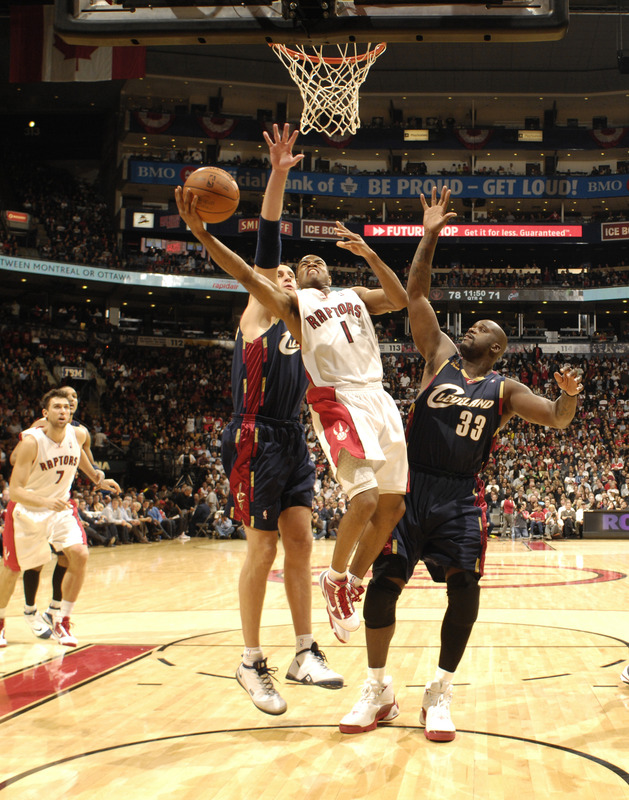 Jarret Jack  of the  Toronto  Raptors   goes  up for the  layup while under  the  defensive  presence  of the  Cavaliers'   Shaquille  O'Neal  in  a  game  played  at  the  Air Canada Arena  in  Toronto , Canada.    picture  appears  courtesy  of  nbae/getty images/   Ron  Turenne  ................