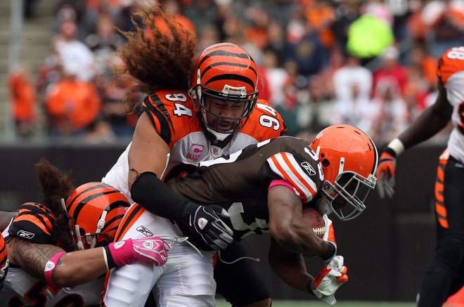Jerome  Harrison  (35)  of  the  Browns  is  tackled   by  the  Bengals'   Domata   Peko  (94)   during  the  game.    picture  appears  courtesy  of getty  images/  Jim  McIsaac  ........................