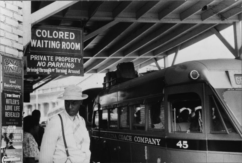 Outside  a  bus stand   in   Durham  ,  North   Carolina   during  the   fifties.    picture  courtesy   wiki/archives/    Race  relations   ................