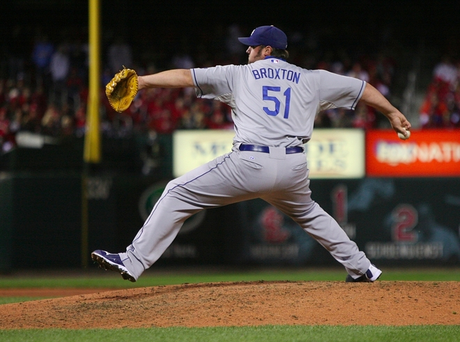 The   Dodgers'   Johnathan  Broxton   delivers   the   final    pitch   of  the   game  against   the   St  Louis   Cardinals     at   Busch   Stadium     in   St   Louis   ,  Missouri  . picture  appears   courtesy  of  getty images/Dilip  Vishnawat   .......