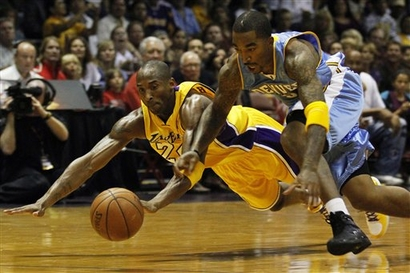 Kobe  Bryant  (left)  of  the  Lakers  and   the  Nuggets'  J R Smith   contest a   loose   ball    during   a  preseason   game    played    Friday  in   San  Diego ,  California .  The   Denver  Nuggets would  go  on to  defeat  the  Los  Angeles  Lakers   119-105 .     picture  appears  courtesy  of    ap/photo/Denis  Poroy   .............