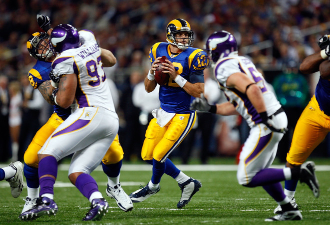 Kyle Boller  (12) of the  St  Louis  Rams  drops  back to  make a  pass against the  Minnesota  Vikings   in a  game  at the  Edward  Jones   Dome  in    St Louis,  Missouri.       The   Vikings  would   go  on to  defeat  the  Rams  38-10   in  a   lopsided   rout.     picture appears   courtesy  of   getty  images/   Ronald  Martinez  ......................