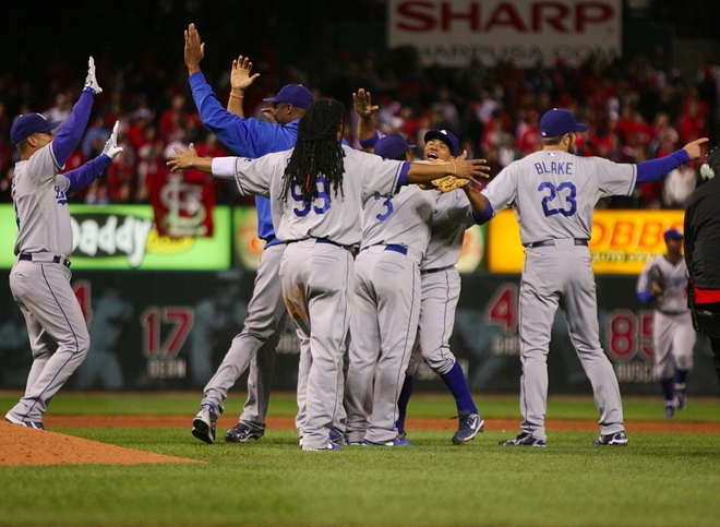 Players   on  the  Los  Angeles   celebrate  their   5-1  victory  over  the    St    Louis  Cardinals   enabling   their clinching    of   NLCS  berth.   They   now   await  the   winners   of  the   series    between  the   Philadelphia  Phillies  and   Colorado  Rockies     to   determine   the  NL   pennant.     picture  appears   courtesy  of   getty   images/   Dilip  Vishwanat  ............