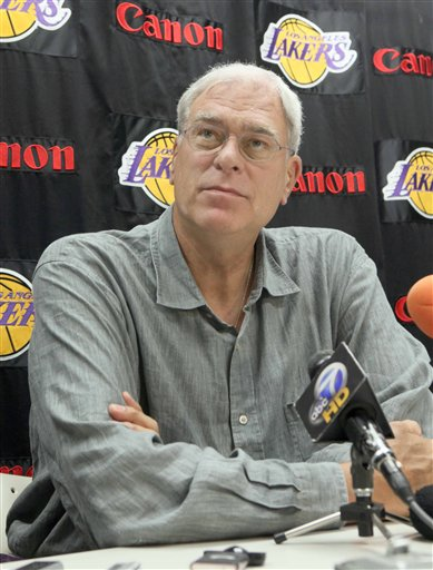 Lakers'  coach  Phil  Jackson  speaks  to  the   members  of  the  media   at  a  news  conference   at the   team's   training  facility  in  El  Segundo  ,  California.      The  team   now  embarks  on the  defense  of  their  2008-09   NBA  title.    picture  appears courtesy  of   ap/photo/  Nick  Ut  ..................