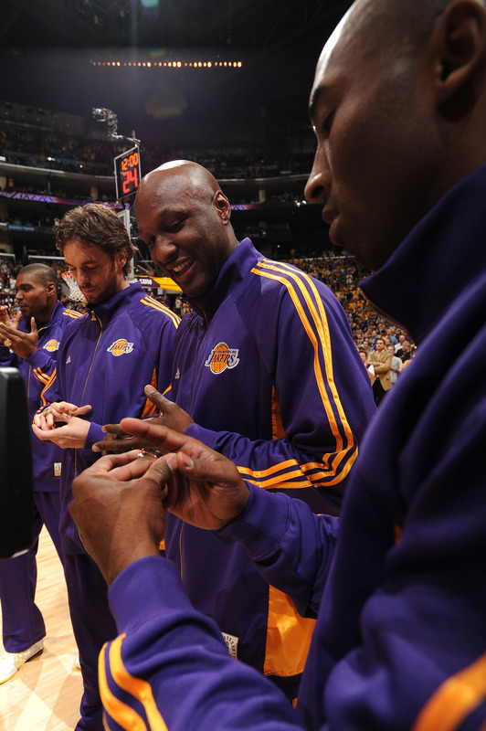 Lakers'  players   from  left to   right   ,  Pau Gasol,  Lamar  Odom  and  Kobe  Bryant   receive their NBA    championship  rings    prior  to  the  season  opener  against the  Los  Angeles  Clippers   at  the  Staples  Arena  in  Los  Angeles ,  California ,.     picture  appears courtesy  of  nbae/getty images/ Andrew  D .  Bernstein  .................