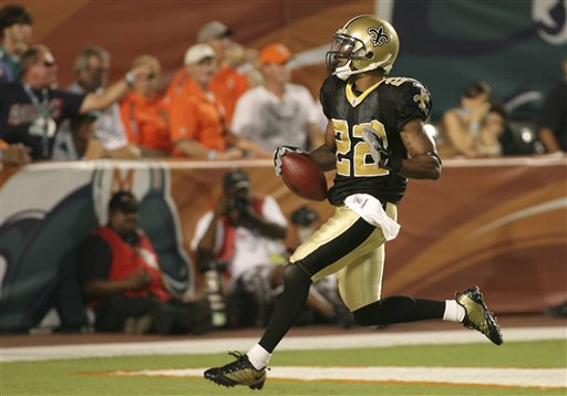 New Orleans  Saints'  cornerback  Tracy  Porter (22)  runs for  the  score  in the   fourth  quarter   against  the  Miami  Dolphins   in a  game  played  at  Land  Shark  Stadium   in  Miami,  Florida.   The  Dolphins   would  give  up  a   24-3  lead  to the  Saints  and    ended  up   losing  46-34   .      picture  appears   courtesy  of  ap/photo/  Jeffrey   M.  Boan      .......................