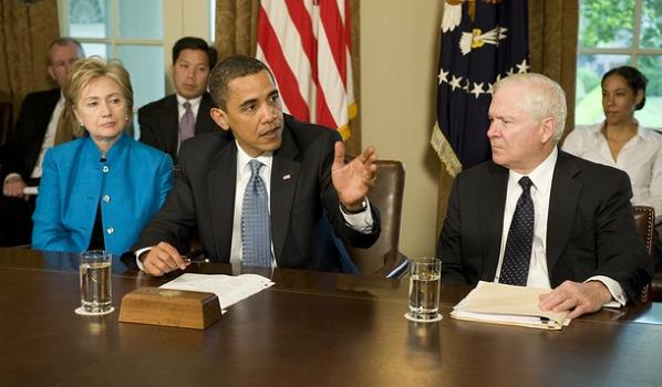 The President   (seated   center)  is  seen  here  with  Defense  Secretary  Robert  Gates  (right )  and   Secretary  of  State  Hillary  Rodham-Clinton  (left)   at     a  meeting   to  discuss  nuclear  proliferation.      picture  appears  courtesy  of    getty  images/  Richard  Scholes  ....................