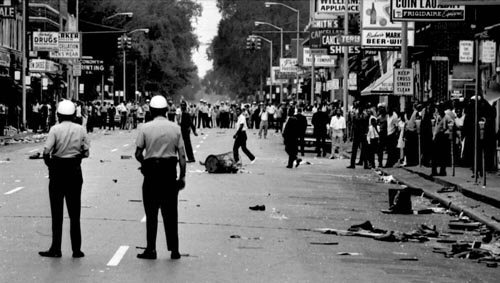One  of the  seminal   moments   in   race   relations    during  the   sixties   the   race  riots   in   Detroit   in   1967 .    picture  appears  courtesy  of   time magazine.com/archives ....................