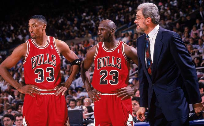 The eternal  triumvirate  of  the  Chicago  Bulls' dynasty . From  left to right   Scottie Pippen ,  Michael Jordan  and  the  team's  coach  Phil  Jackson.  Through  the  early to  mid  nineties  the  team  was  the  dominant  force in the  NBA  having  won  6  NBA championships  in an  eight year  span.   picture  appears courtesy of  Sports Illustratred  si.com/  Manny  Millan  ...............