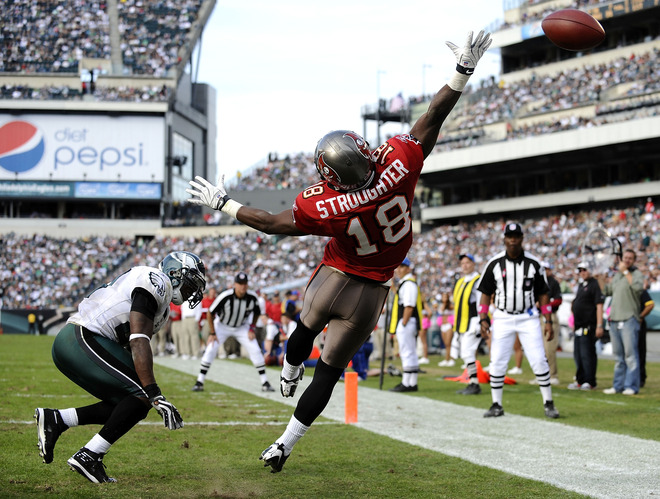 Bucs'  wide receiver  Sammie  Stroughter  (18) makes a   valiant   attempt  to  catch  the  ball  in the  endzone   during  the   game   played  against  the  Philadelphia   Eagles.   Looking  on  is  Eagles'   defensive  player    Dimitri  Patterson  (23)    as   the  miscue  is  made.    The   Eagles   would   go  on  to  defeat  the  Bucs  33-14    in  the  NFC  game  played  at    Lincoln  Financial Field  in  Philadelphia,  Pennsylvania ,.      picture  appears courtesy  of   getty images/  Jeff  Zelevansky     ......................