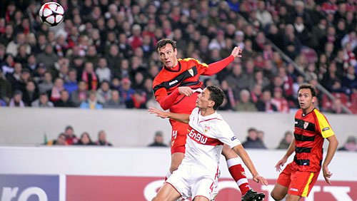 Sebastian  Squillaci  heads  home   Seville's  opener   in their  3-1   win  over  VfB  Stuttgart    at  the  Mercedez  Benz  Arena   in  Stuttgart   , Germany.    picture  appears   courtesy   of  getty  images/   Christian   Reiner  ....................