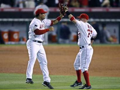 Angels'  teammates  Bobby  Abreu (left)  and  Reggie  Willits  (right)  celebrate   after the  team's   victory   in  game   5  of the  ALCS  over   the  New   York  Yankees  .       picture  appears   courtesy  of   getty  images/  Harry  How  ......................