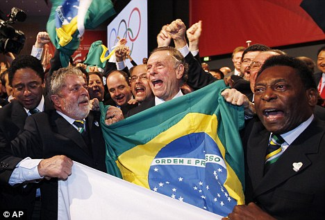 The  Brazilian  Olympic  Committe delegation  celebrates  their   triumph  in  winning  the  bid  to   host  the   2016  Olympics  in  Rio  De  Janeiro  ,  Brazil  .     To  the  right   is  Brazilian   soccer   legend  Pele  who   was  at  the    forefront  of  his    country's  bid.    To  the  left  is   Brazilian   President  Luiz  Inacio    Lula  De  Silva .     It   was  a  monumental   triumph  for  the   South  American  country.      picture  appears  courtesy   of  ap/photo/  Roberto  Garcia  ..........................