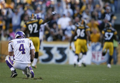 Vikings'  quarterback  Brett  Favre (4)  watches  as the   Pittsburgh  Steelers'  Keyaron  Fox  (57)  returns  a TD  interception   for   82 yards   in  the  fourth    quarter   of  the   game  played  at  Heinz  Field    in  Pittsburgh   Pennsylvania,.     The  Steelers   would    go  on  to   defeat  the  Vikings   27-17   inflicting them  with  their    first   loss  of the  season.        picture appears  courtesy  of   ap/photo/Star Tribune/   Jerry   Holt   ........................