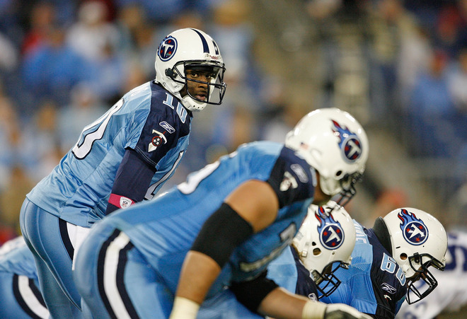 Titans'   quarterback Vince  Young  (10)  lines  up   behind the  line of  scrimmage  as  he  prepares  for  a  play   against   the   Indianapolis  Colts    at  LP Field   in   Nashville,  Tennessee ,.   The  Titans   would   go   on  to  lose   the  divisional  game  to their   AFC South  rivals  .   The  end   result   was  a  31-9    walloping  at the  hands   the   Peyton  Manning   led   Indianapolis  Colts.          picture  appears  courtesy of   getty  images/  Andy  Lyons   ...............