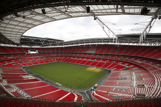 Wembley   Stadium  in  London.  Where  this  weekend  the  NFL  will  stage  a  regular  season  game  between  the New  England  Patriots  and  the  Tampa  Bay  Buccaneers .    The  venue  can   hold   up  90,000   people  for  a  sporting  event.       picture  appears  courtesy  of    thetimes.co.uk/   Martin  Webster   ..........................