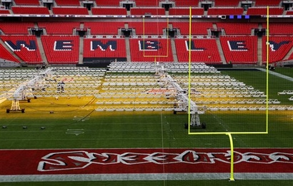 Wembley  Stadium  is  prepared   for   Sunday's    NFL  game  between  the  New  England Patriots  and  Tampa  Bay  Buccaneers.  This  will  be  the   third   consecutive   year  that  a  regular  season   scheduled  game   has  been  held  at  the  venue   in  London.    picture  appears   courtesy  of  ap/photo/  Sang  Tan   ...............