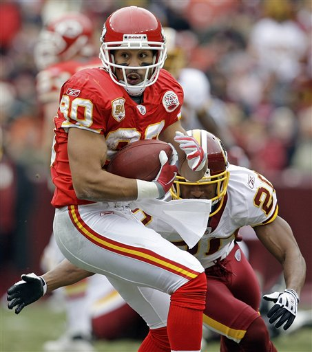 Wide   receiver   Bobby  Wade  of  the  Chiefs   escapes the   grasp  of   Redskins'  cornerback   Justin  Tryon  during  the   third  quarter  of  the  game   played   at    Fedex  Field  ,   Landover ,  Maryland .   The   Kansas  City  Chiefs   would  go   on to  defeat     Washington  Redskins    14-6  in   a   game    that   went   without  a   touchdown  being   scored  .   All  the   points  came   from  field  goals  and   the  Redskins'   quarterback  Todd  Collins  being   tackled   in  the  endzone   for 'a safety' .       picture  appears    courtesy  of ap/photo/  Alex Brandon   ........................