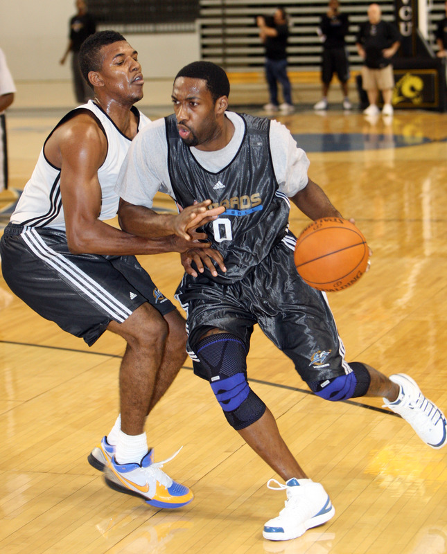 Gilbert  Arenas (0)   of  the  Washington  Wizards  seen   here  at   the  team's   training   facility  at  the Siegel  Center   on  the  campus  of   Virginia  Commonwealth  University  in  Richmond  , Va.    Facing  off    against   Arenas  is   teammate     Nick  Young  (1)  during  team practice.       picture appears   courtesy  of  nbae/getty   images/   Ned  Dishman  ...............