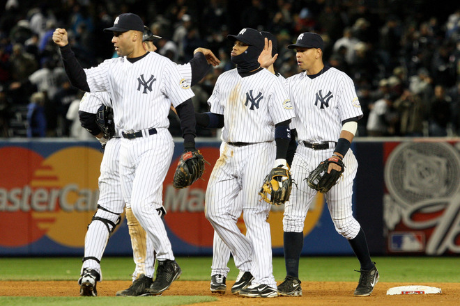 Yankees'  captrain   Derek  Jeter  and   his   teammates   celebrate   after their  4-1   victory  over  the  Los  Angeles  Angels   in  game 1  of  the  ALCS   played  at   Yankees   Stadium i   in the  borough  of  Brooklyn ,  New  York,.    picture appears   courtesy  of   getty images/ Jim McIsaac   ........................