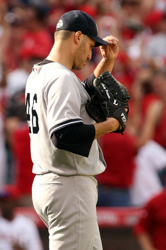 Yankees'  starting  pitcher   in   game   3,  Andy  Pettite   reacts   after     Vladimir  Guerrero of  the  Angels   hits   a  two   run  homer  of   him  in  the  sixth   inning.       picture appears  courtesy  of  getty  images  / Stephen   Dunn ....................