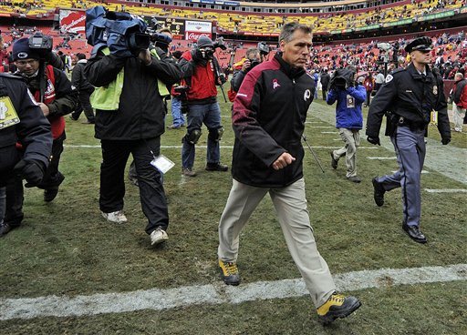 Zorn   leaves  the   field  after  the  Redskins'   loss   to  the  Kansas  City   Chiefs.        picture  appears   courtesy of   ap/photo/  Mike   Wass  ................